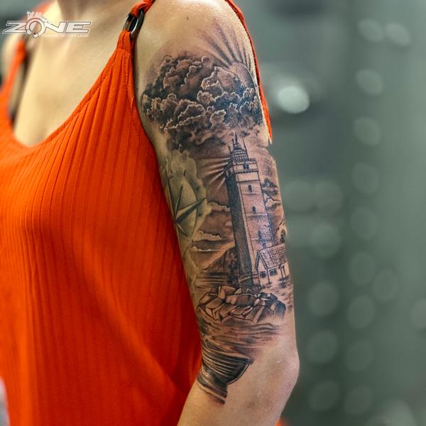 Zone -Tattoo - Piercing - Dilo - Black and grey - Leuchtturm - Oberarm - Braunschweig